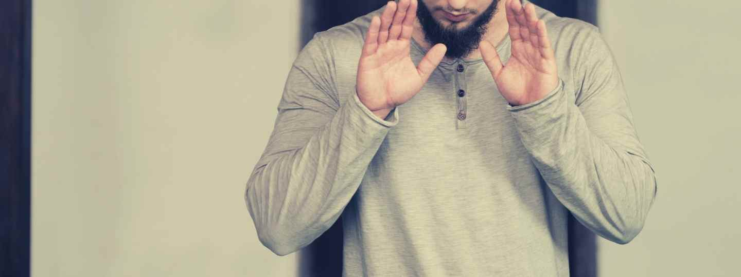Is using two hands always an invalidator of Salah?